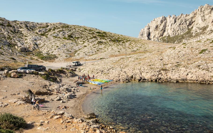Visitors settle in for the day in the National Park of Calanques, France.