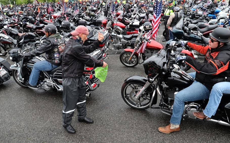 Motorcyclists are guided into place in the RFK Stadium staging area before the Rolling to Remember ride, May 30, 2021 in Washington, D.C..