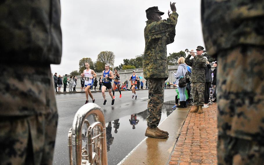 Runners in the 2019 Marine Corps Marathon pass the United States Marine Band at mile 10, at the foot of the Lincoln Memorial in Washington, D.C.