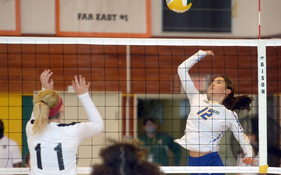 Yokota's Elena Haas readies a spike against Zama American's Kaitlin McAbee during Saturday's Japan girls volleyball match. The Panthers won in four sets.