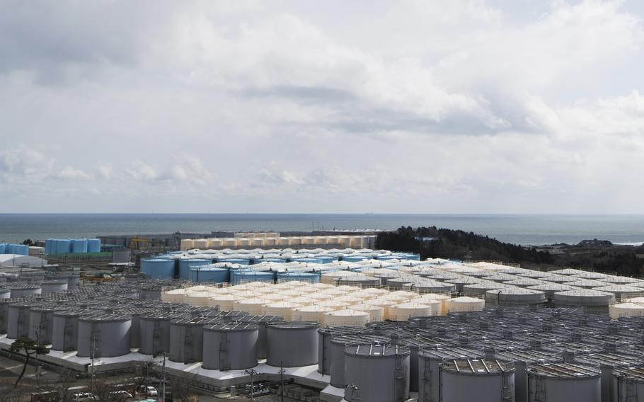 Tanks (in gray, beige and blue) store water that was treated but is still radioactive after it was used to cool down spent fuel at the Fukushima Daiichi nuclear power plant in Okuma town, Fukushima prefecture, northeastern Japan, Feb. 27, 2021. Technicians at Japan's wrecked Fukushima nuclear power plant neglected to investigate the cause of faulty filters that were discharging dangerously radioactive water into the sea, company officials admitted Tuesday, Sept. 14, 2021, after being forced to repair the filters.