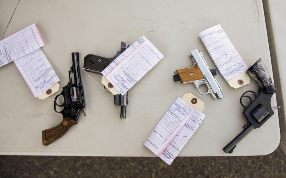 Fully processed guns that will later be destroyed sit on a table during a gun buyback exchange at Encanto Southern Baptist Church on  June 5, 2021. Unwanted pistols and rifles were exchanged for 00 and 00 gift cards.