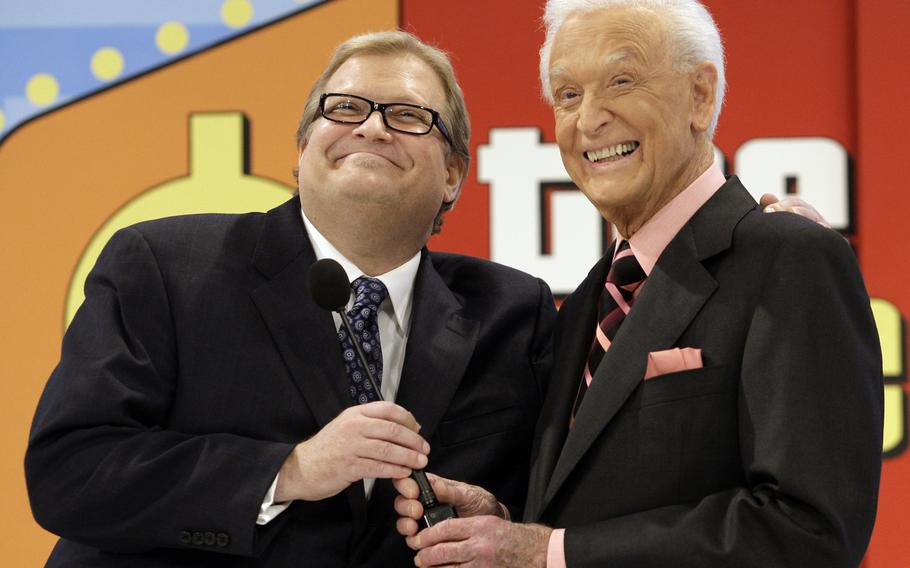 """The Price is Right show host, comedian Drew Carey, left, appears with longtime former host Bob Barker at the CBS Studio Center in Los Angeles on March 25, 2009. Barker, who retired and passed the microphone off to Carey, appeared on the show to promote his autobiography, """"Priceless Memories."""" The longest-running game show in television history is celebrating it's 50th season."""