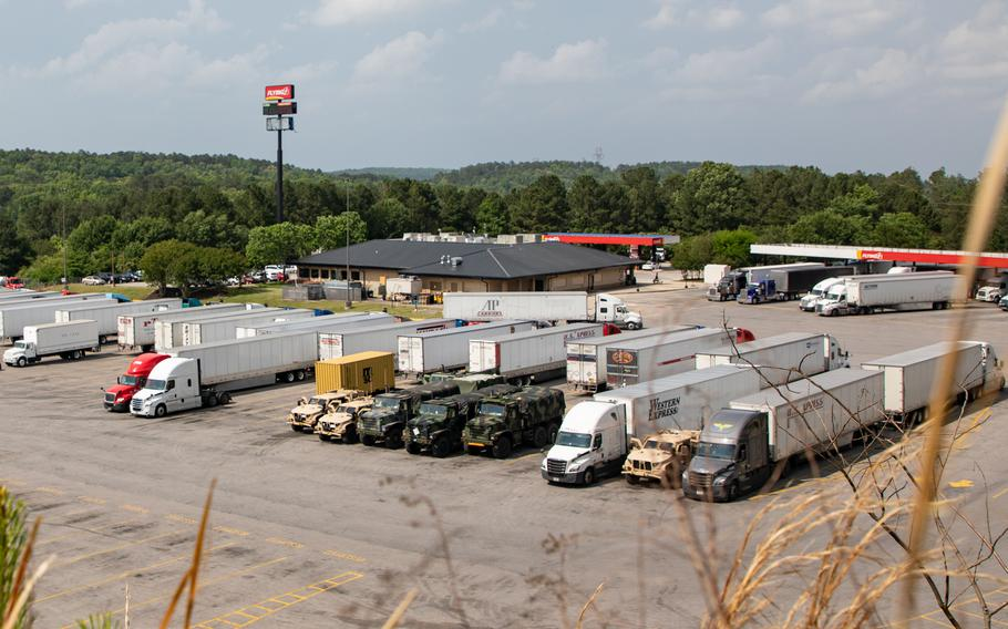 Marines stage vehicles at a truck stop near Tuscaloosa, Ala., May 3, 2021. Marines in tactical vehicles and trucks drove from Camp Lejeune, N.C., to Twentynine Palms, Calif., in one of the longest convoys in the service's history.