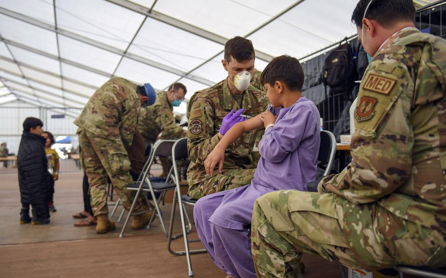 Airmen assigned to the 86th Medical Group administer the mumps, measles and rubella, and chickenpox vaccines to an Afghan evacuee at Ramstein Air Base, Germany, Sept. 18, 2021.The Centers for Disease Control and Prevention wants  evacuees inoculated against measles recently at U.S. military bases overseas to wait three weeks before traveling to the U.S., the agency said.
