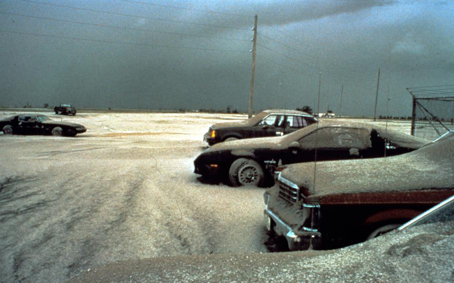 Ash covers the ground and cars at Clark Air Base, Philippines, a day after the eruption of Mount Pinatubo on June 15, 1991.