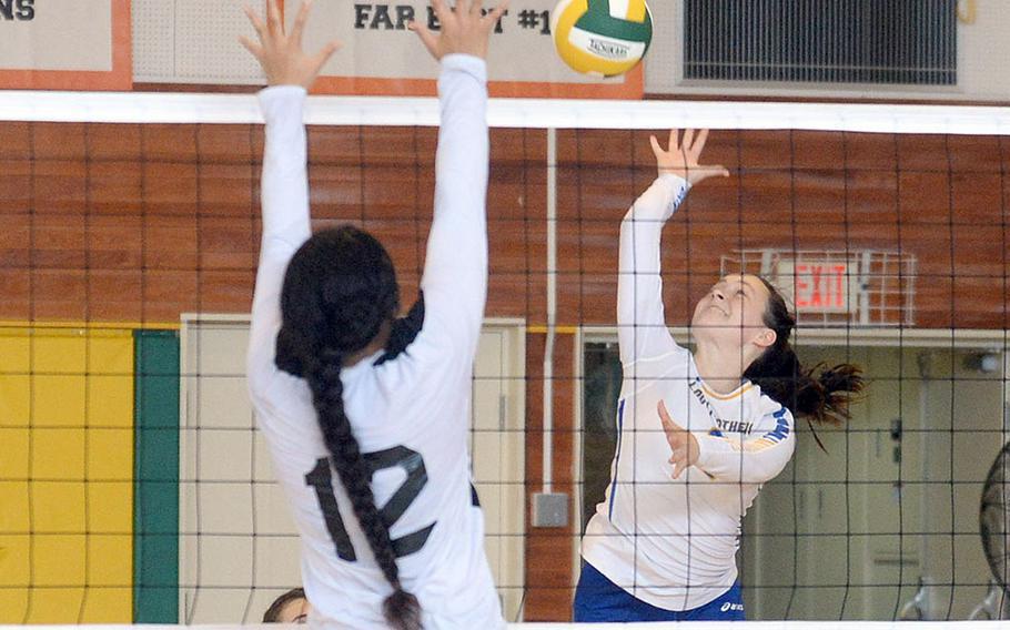Yokota's Malia Hutchins readies a spike against Zama's Kierstyn Aumua during Saturday's Japan girls volleyball match. The Panthers won in four sets.