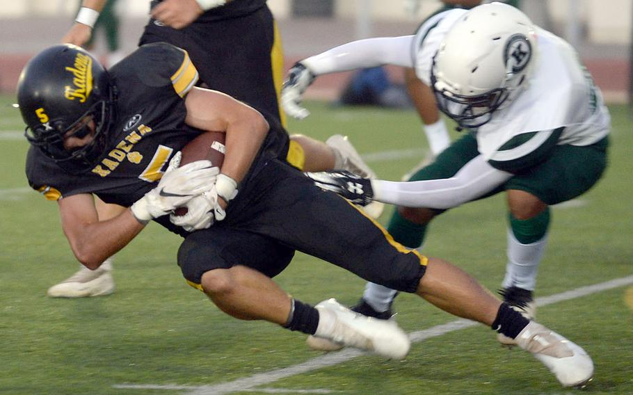 Kadena running back Trent Fowler leans for a couple of extra yards against Kubasaki.