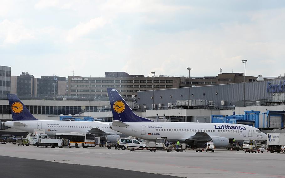 Lufthansa planes wait at a Frankfurt International Airport terminal in 2019.
