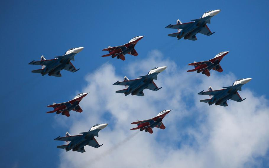 The Russian Knights and Strizhi aerobatic units fly Sukhoi Su-30SM and Mikoyan MiG-29 fighter jets during the victory day parade in Moscow on June 24, 2020.