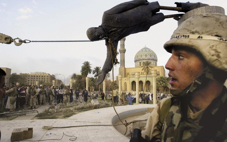 Iraqi civilians and U.S. soldiers pull down a statue of Saddam Hussein in downtown Baghdad, in this April 9, 2003. The U.S. invaded Iraq on false claims that Hussein was hiding weapons of mass destruction.