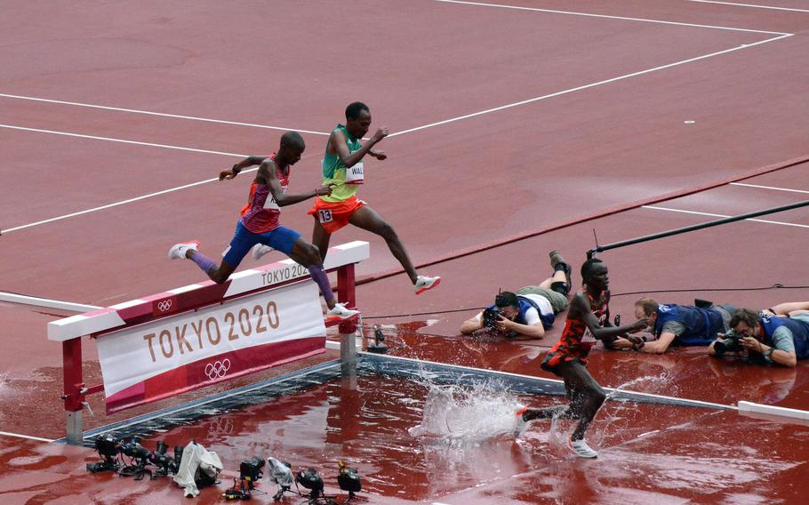 Army Spc. Benard Keter, left, ran a personal best 8:17.31 to reach the Olympics steeplechase final at new National Stadium in Tokyo, July 30, 2021.