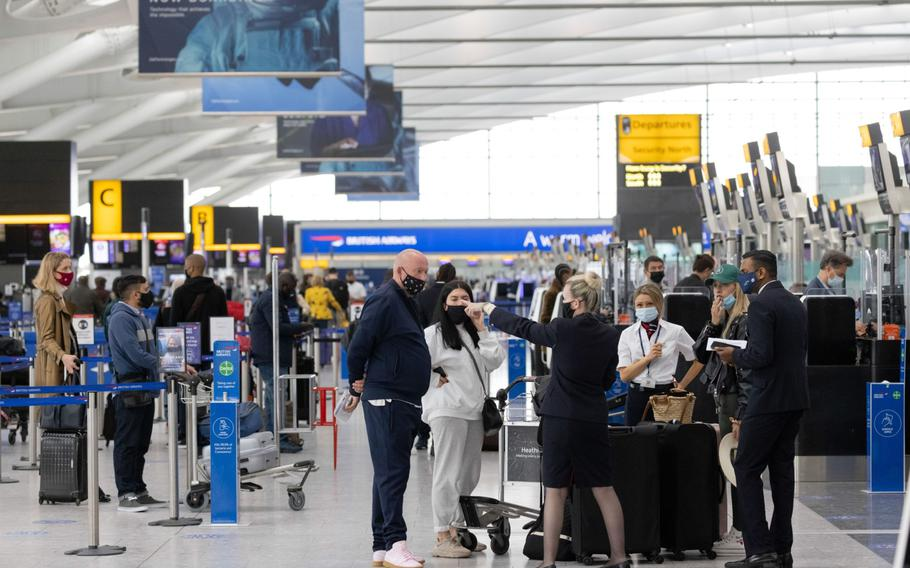 Passengers check in at London Heathrow on May 17, 2021.