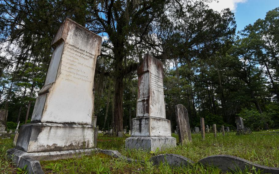 Grave markers in the Taylor's Creek cemetery on the Army's Fort Stewart in Georgia mark the burial site of two Confederate soldiers. The cemetery, one of 60 on the installation, dates back to the 1840s.