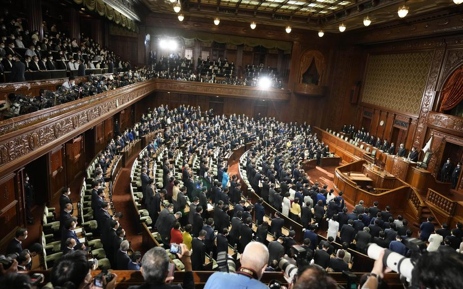 Lawmakers listen to the announcement of the dissolution of the lower house Thursday, Oct. 14, 2021, in Tokyo. Japan's new Prime Minister Fumio Kishida dissolved the lower house of parliament Thursday, paving the way for Oct. 31 national elections.