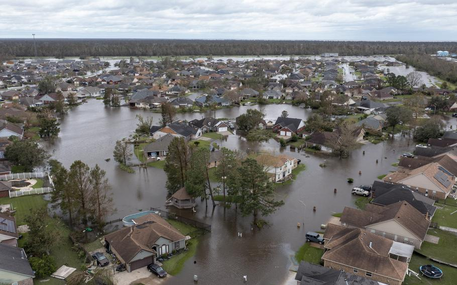 Flooded streets and homes are shown in the Spring Meadow subdivision in LaPlace, La., after Hurricane Ida moved through Monday, Aug. 30, 2021. Hard-hit LaPlace is squeezed between the Mississippi River and Lake Pontchartrain.