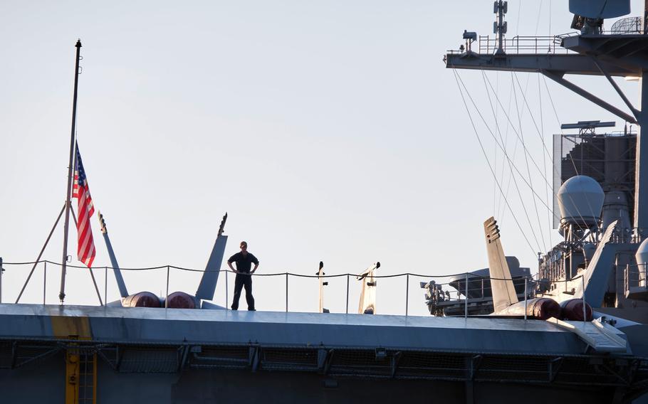 The USS Carl Vinson aircraft carrier arrives for a port call at Yokosuka Naval Base, Japan, Saturday, Aug. 28, 2021.