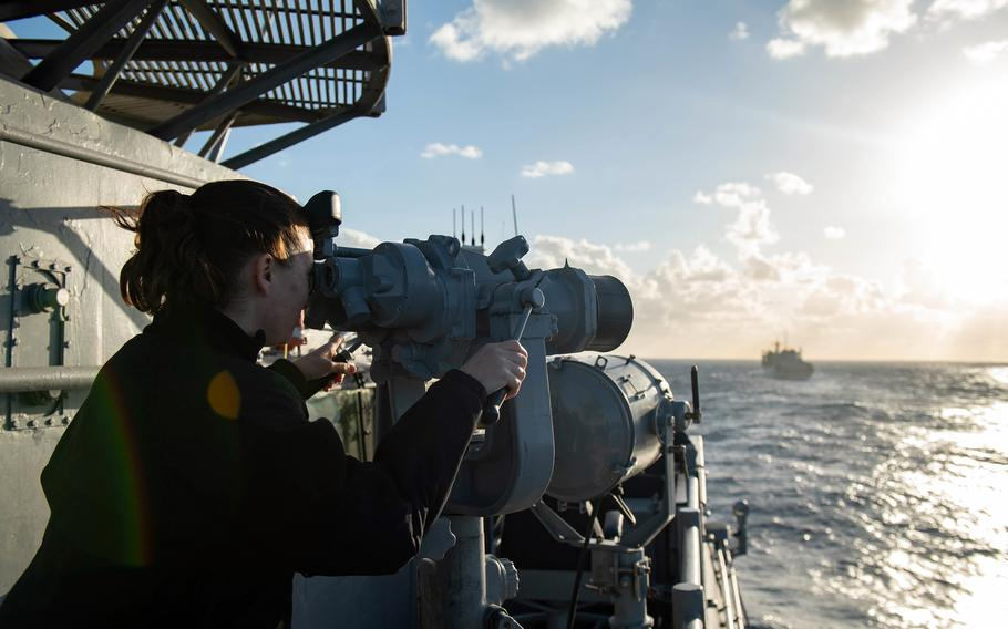 A sailor aboard the guided-missile cruiser USS Monterey looks out at the Mediterranean Sea, March 17, 2021.