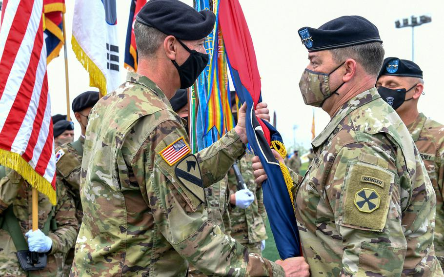 Maj. Gen. David Lesperance accepts the 2nd Infantry Division colors from Eighth Army's commander, Lt. Gen. Willard Burleson, at Camp Humphreys, South Korea, Tuesday, May 18, 2021.