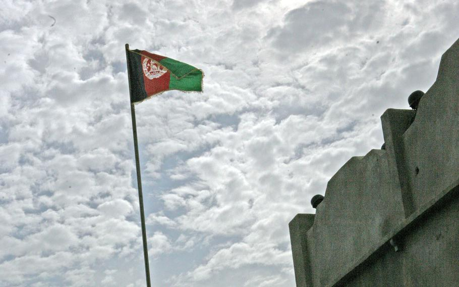 An Afghanistan flag is raised over Helmand province in 2010.