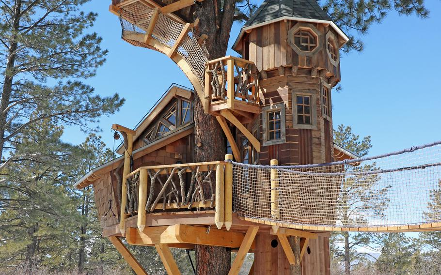This undated photo provided by Aaron Smith, who owns Treecraft Design-Built in Fort Collins, Colorado, shows a Pagosa Springs treehouse Smith and his firm built. Smith said interest in treehouses has increased in the last few years.