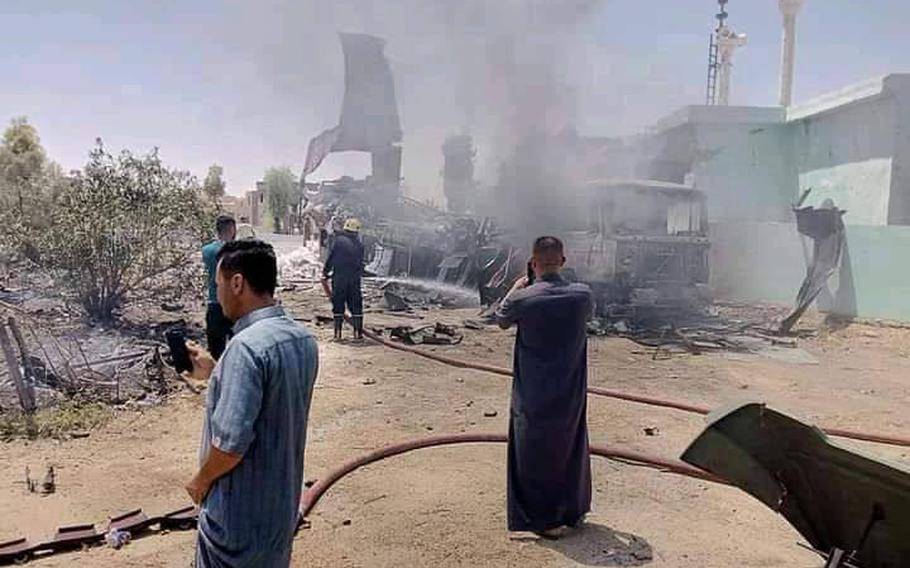 Iraqis inspect the damage after al Asad Air Base was hit in a rocket attack, July 7, 2021. It was the second rocket attack targeting the base this week and follows two attempted drone attacks on U.S compounds elsewhere in Iraq.