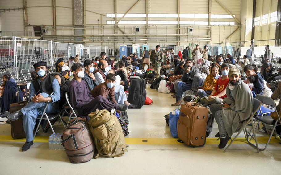 Afghan evacuees wait for flights to the U.S. in a hangar at Ramstein Air Base in Germany on Wednesday, Sept. 1, 2021.