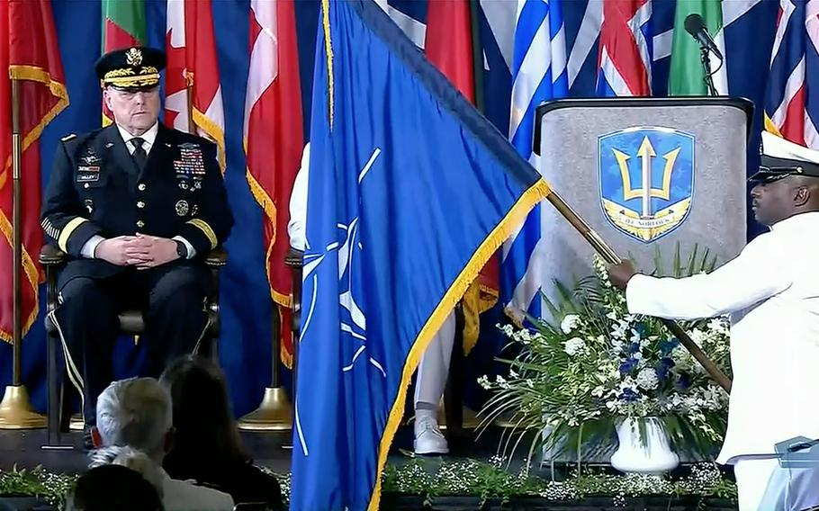 In a screenshot from a Defense Department live feed, Army Gen. Mark A. Milley, chairman of the Joint Chiefs of Staff, watches as the NATO flag is presented aboard the USS Kearsarge during a ceremony marking the alliance's Joint Force Command Norfolk fully operational, July 15, 2021. JFC Norfolk is the only NATO joint command in the U.S.