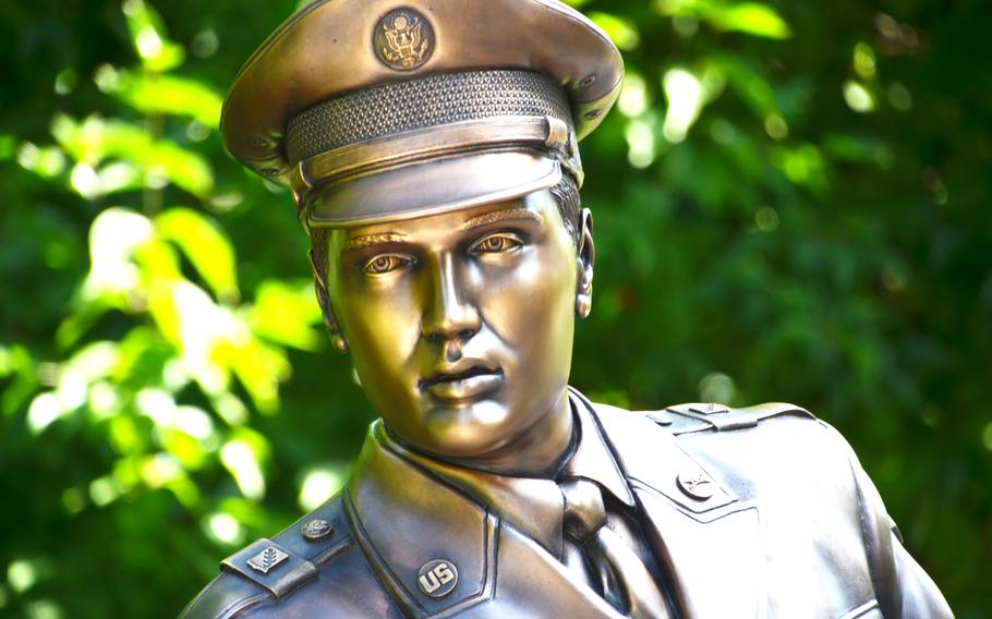 A statue of Elvis Presley, paid for by fans, stands on a bridge in a park in Bad Nauheim, Germany, where the American singer lived from 1958-1960 when he served in the Army.