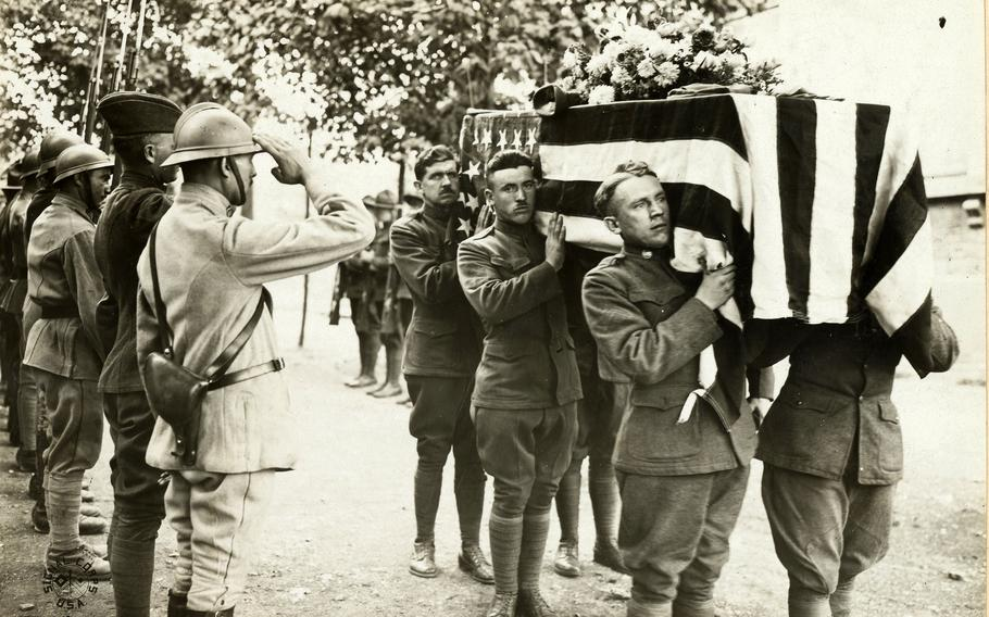 French and American Soldiers salute at the funeral of one of their comrades at base hospital No. 17, Dijon, France, on Sept. 6, 1918.