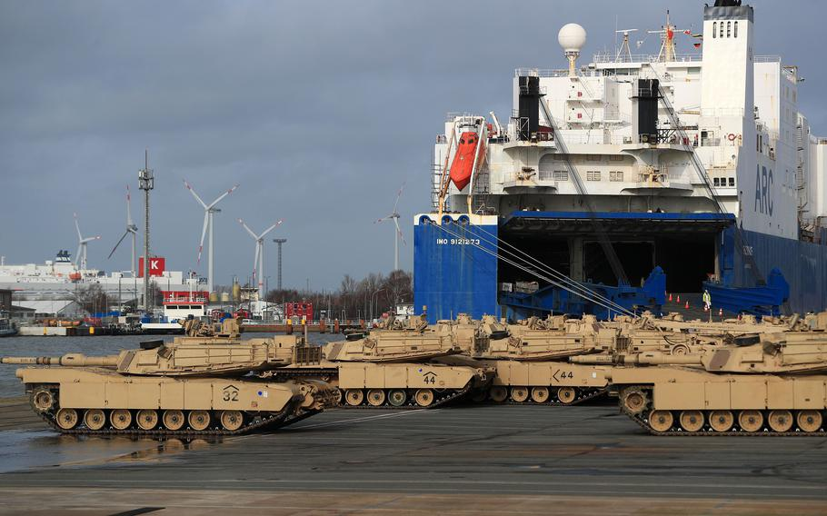 A platoon of M1 Abrams battle tanks, manufactured by General Dynamics Land Systems, sits next to the Endurance vehicle carrier during the U.S.-led NATO Defender Europe-20 Exercise at the Port of Bremerhaven in Bremerhaven, Germany, on Feb. 21, 2020.
