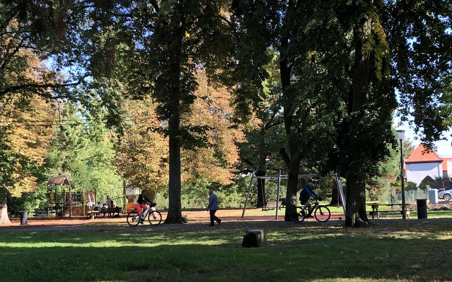 A city park in Wissembourg, France, has a playground and walking paths.