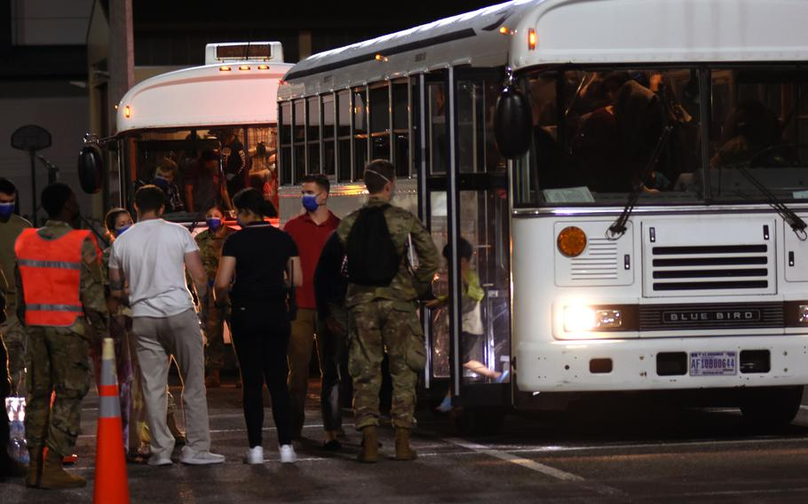 A little boy steps off the bus at Ramstein Air Base, Germany, on Friday, Aug. 20, 2021, after arriving on a U.S. military flight from Al Udeid Air Base, Qatar. The boy was one of hundreds of evacuees from Afghanistan who were to spend the night Friday at Ramstein, which is prepared to temporarily support up to 5,000 people as they move to the United States and elsewhere after fleeing the Taliban.