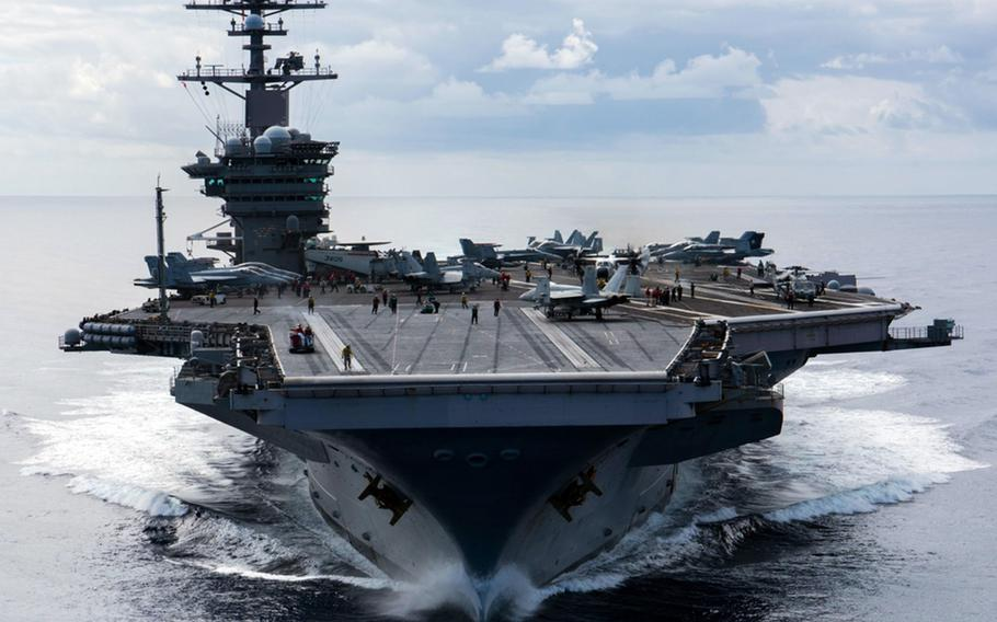 The aircraft carrier USS Carl Vinson, shown here somewhere in the Pacific Ocean in 2018, is slated to visit Yokosuka Naval Base in Japan for the first time in nearly two decades.