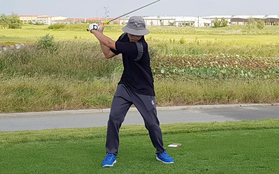 Humphreys Gold's Trevor Yi drives the fairway during Thursday's DODEA-Korea season-opening golf match. Yi and Gold edged Humphreys Black 4-3.