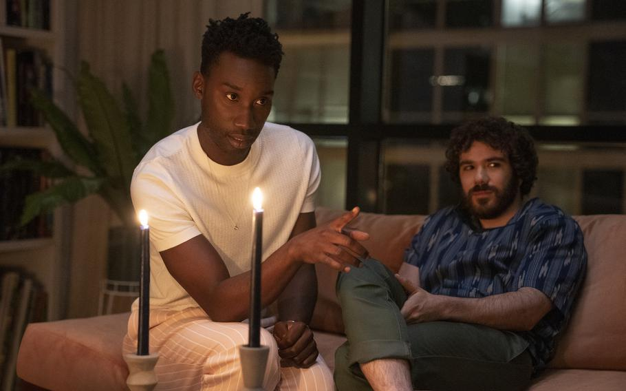 """This image released by Universal Pictures shows Nathan Stewart-Jarrett and Kyle Kaminsky in a scene from """"Candyman,"""" directed by Nia DaCosta."""