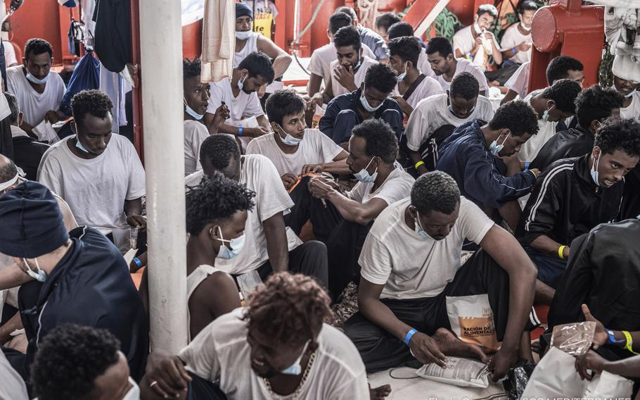 Migrants receive food while aboard the Ocean Viking rescue, in the Mediterranean Sea on Thursday, July 8, 2021.