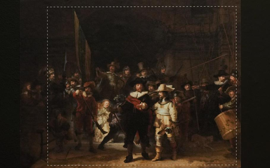 A photograph with lines showing the added parts explains how Rembrandt's biggest painting the Night Watch just got bigger with the help of artificial intelligence in Amsterdam, Netherlands, Wednesday, June 23, 2021. The Dutch national museum and art gallery reveals findings from a long-term project to examine in minute detail Rembrandt van Rijn's masterpiece the Night Watch.