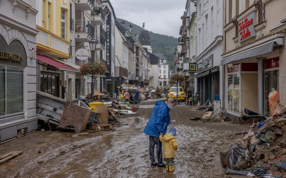 People walk through the flood damaged city center of Bad Neuenahr, Germany on July 16, 2021.