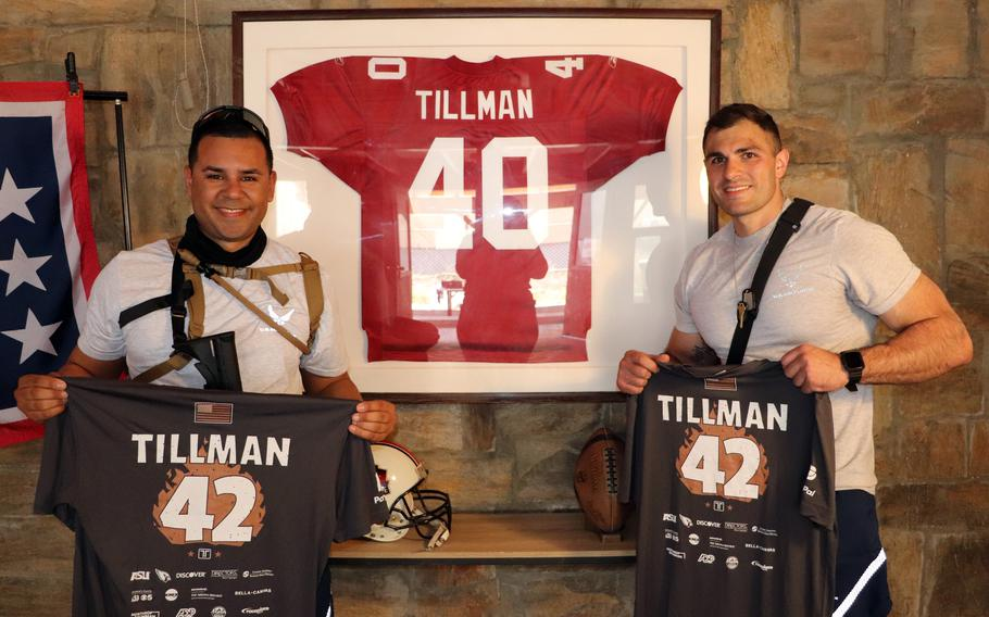 Airmen pose with the jersey of Pat Tillman, a former NFL player who joined the Army Rangers, after a memorial run April 23, 2021 at Bagram Airfield, Afghanistan.