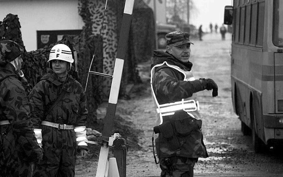 Taszar AB, Hungary, January, 1996: A soldier directs traffic at Taszar AB.