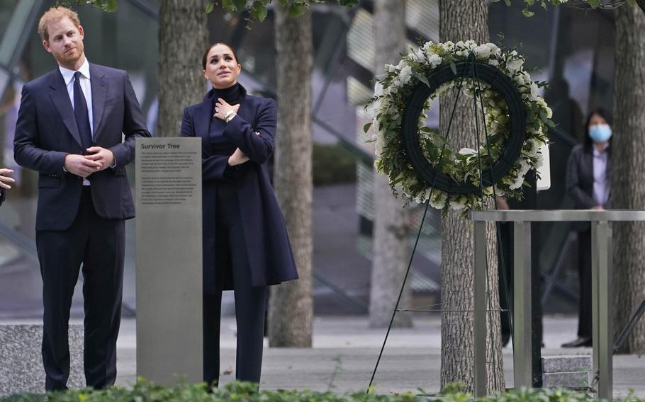 Prince Harry and Meghan Markle pause while getting a tour of the National September 11 Memorial & Museum in New York, on Thursday, Sept. 23, 2021.