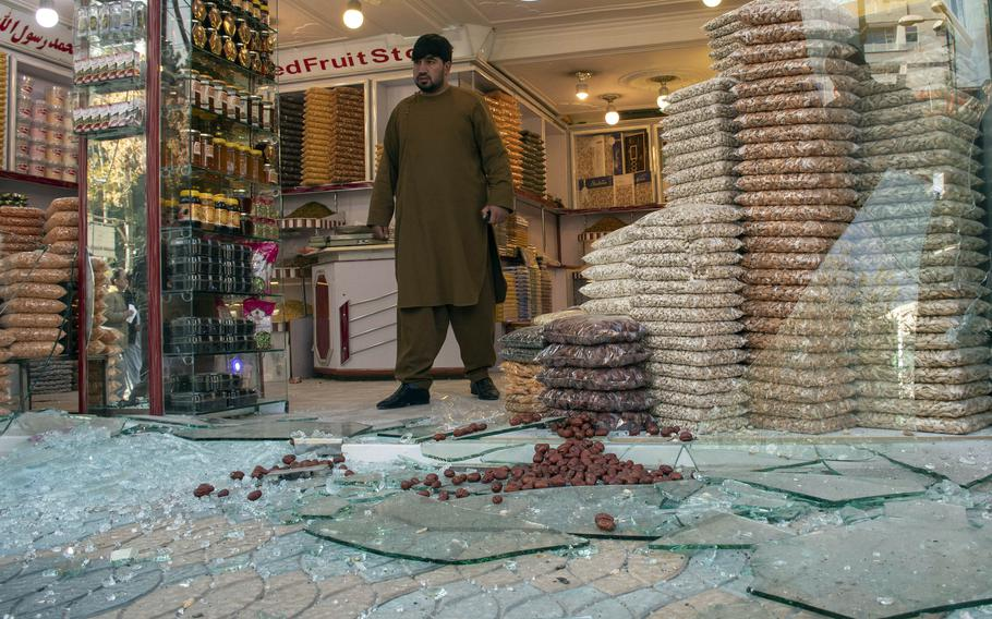 A man exits a shop damaged by rocket fire in Kabul, Afghanistan, in November 2020. The number of deaths and casualties in the country is going up at a record pace this year, the United Nations said July 26, 2021.