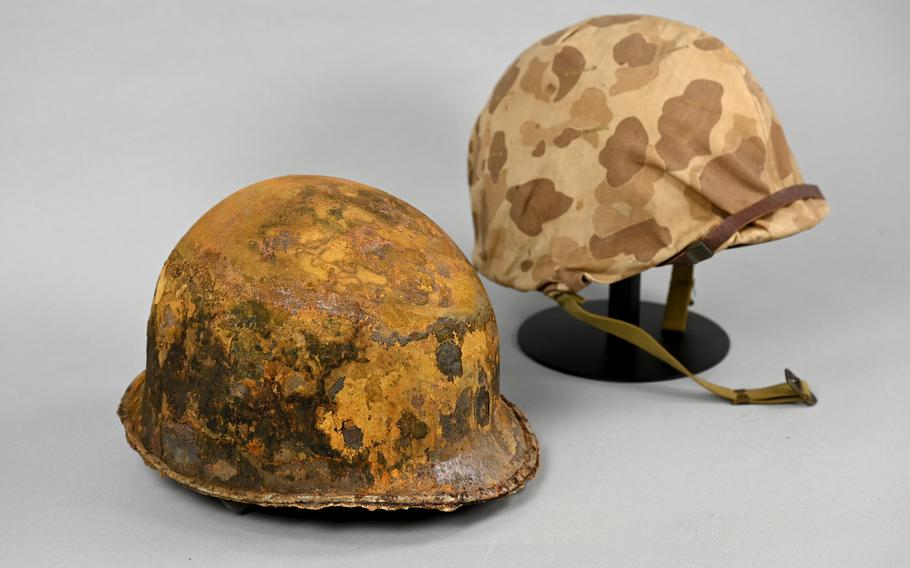 A helmet used during the battle for Tarawa in 1943 is paired with an unused version at the National Museum of the Marine Corps.