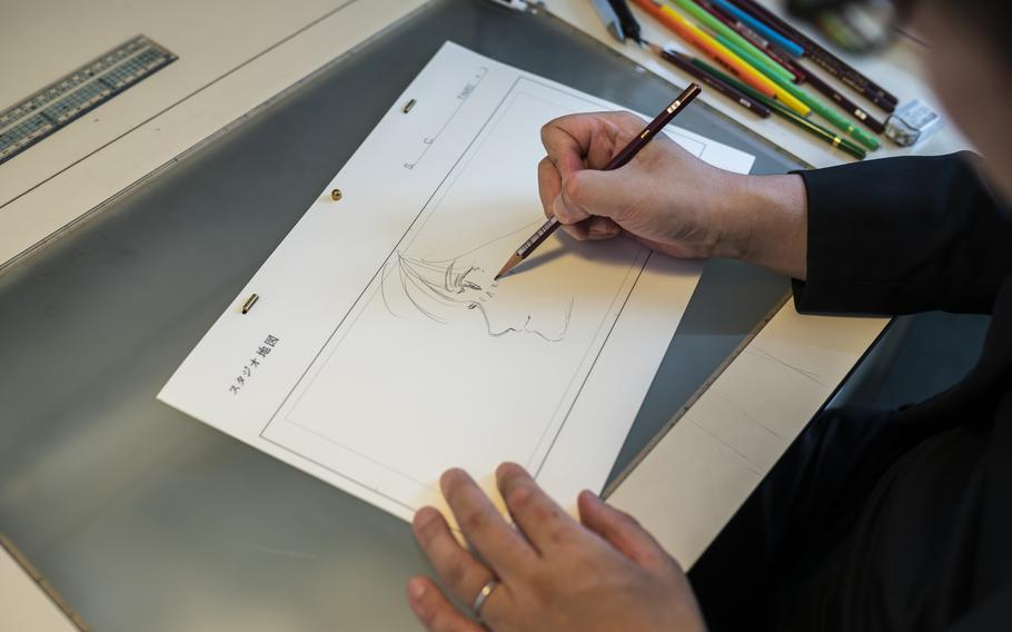 Mamoru Hosoda draws at his office in Studio Chizu in Tokyo on Sept. 9.