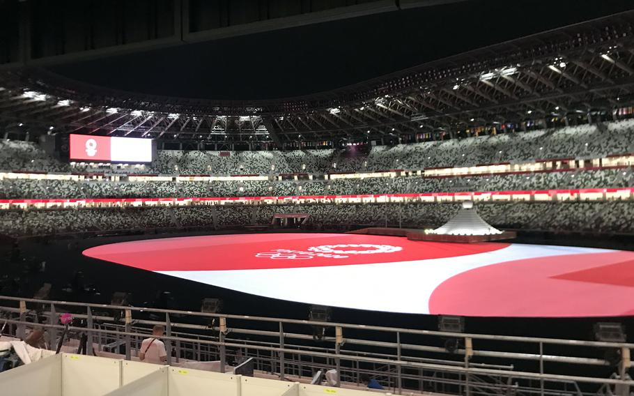 The opening ceremony for the pandemic-delayed Tokyo Olympics gets underway at a nearly empty National Stadium, Friday, June 23, 2021.