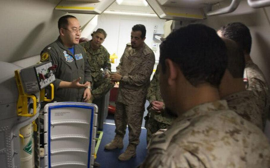 U.S. Navy Lt. Fan Yang, left in this 2018 photo, is scheduled to stand trial next month on charges rooted in a federal investigation of Chinese business executive Ge Songtao.