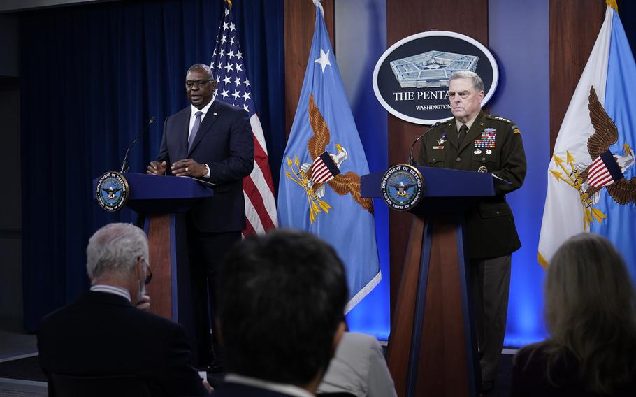 Secretary of Defense Lloyd Austin, left, answers a question during a briefing with Chairman of the Joint Chiefs of Staff Gen. Mark Milley, right, at the Pentagon in Washington, Wednesday, Sept. 1, 2021, about the end of the war in Afghanistan.