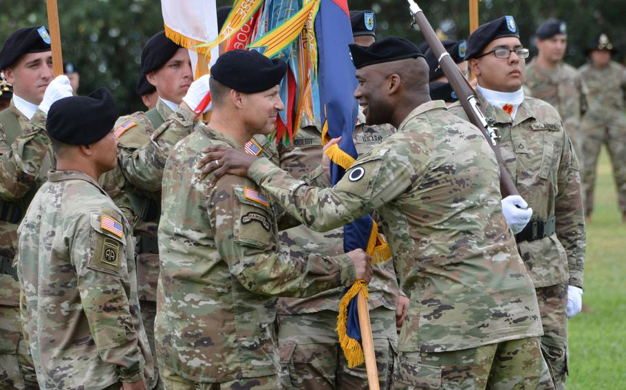 I Corps Commander Maj. Gen. Xavier Brunson, right, congratulates Brig. Gen. Joseph Ryan for taking command of the 25th Infantry Division during a ceremony at Schofield Barracks, Hawaii, Friday, July 23, 2021.