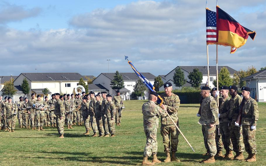 Gen. Christopher Cavoli, left, the U.S. Army Europe and Africa commander, passes the 2nd Multi-domain Task Force colors to Col. Jonathon Byrom at an activation ceremony for the unit Sept. 16, 2021, in Wiesbaden, Germany.